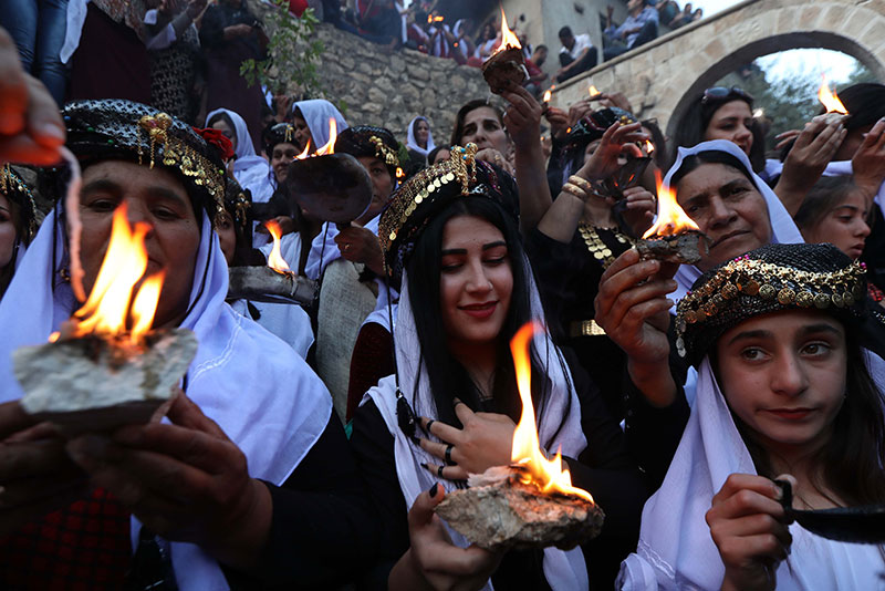 Candles and flashlights for the Yazidi new year.