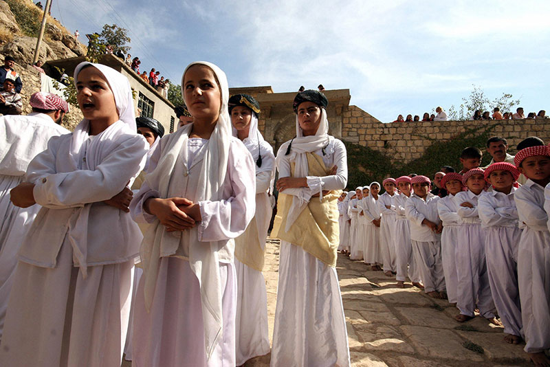 Girls and boys of a Yazidi religious school sing hymns and prayers at Lalish temple.