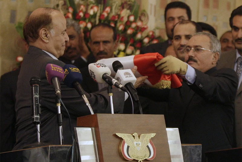Transfer of power from Yemen's former President Ali Abdullah Saleh (on the right) to newly elected President Abed Rabbu Mansour Hadi on February 27, 2012.